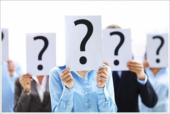 Business people standing with question mark on boards